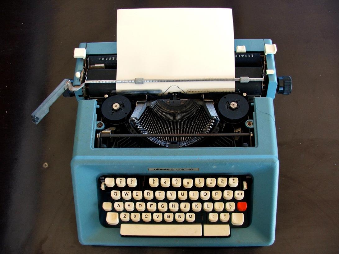 a blue Olivetti typewriter